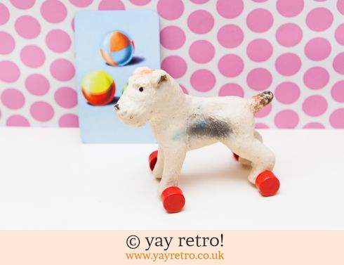0: Vintage Squeaky Dog on Red Wheels (£16.95)