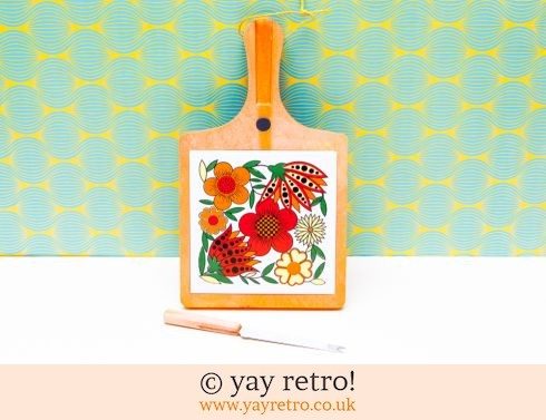 55: Bright Orange 70s Flowery Cheese Board (£18.00)