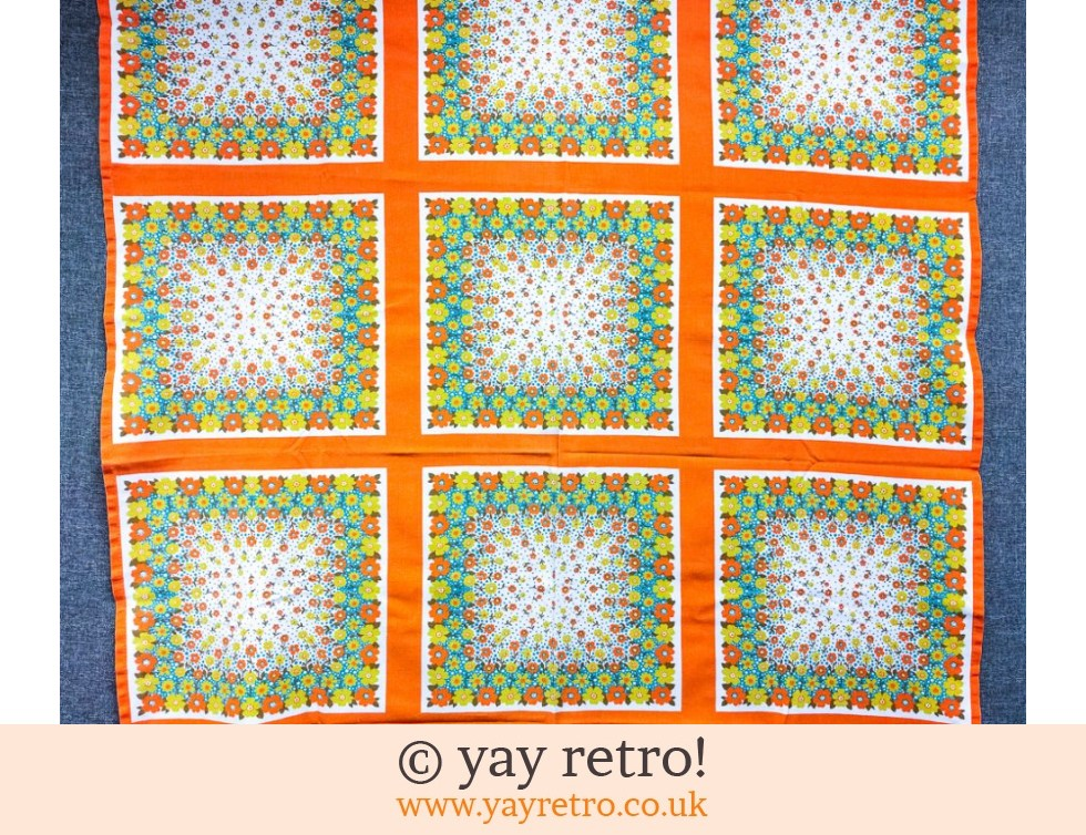 Orange Ditsy Flower Power Tablecloth (£19.50)