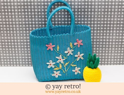 0: Woven Plastic Shopping Bag with Raffia Flowers (£12.00)