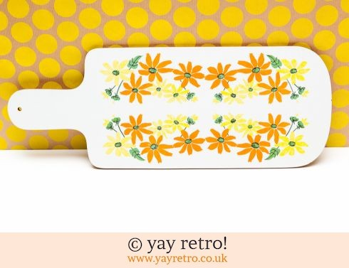 55: 70s Orange Flowery Chopping Board (£10.00)